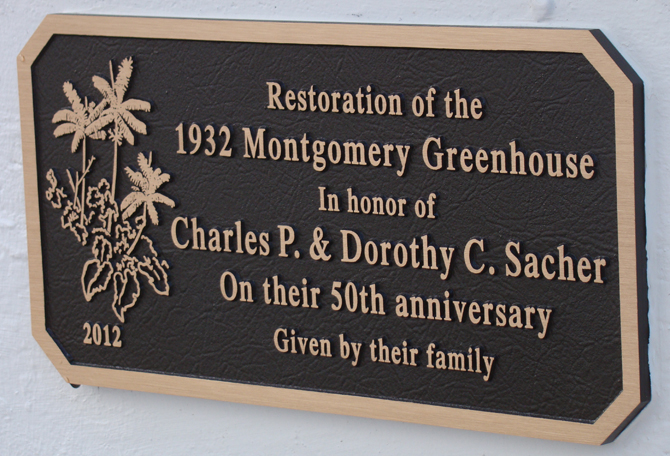 Plaque reads: Restoration of the 1932 Montgomery Greenhouse in honor of Charles P. & Dorothy C. Sacher on their 50th Anniversary, given by their family.
