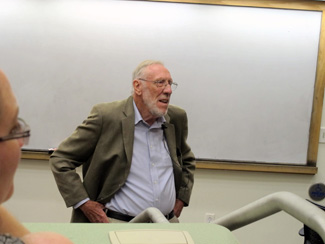 Photo of Dr. Barry Tomlinson giving a lecture