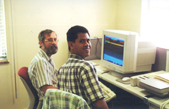 Photo of Dr. Larry Noblick using the computer